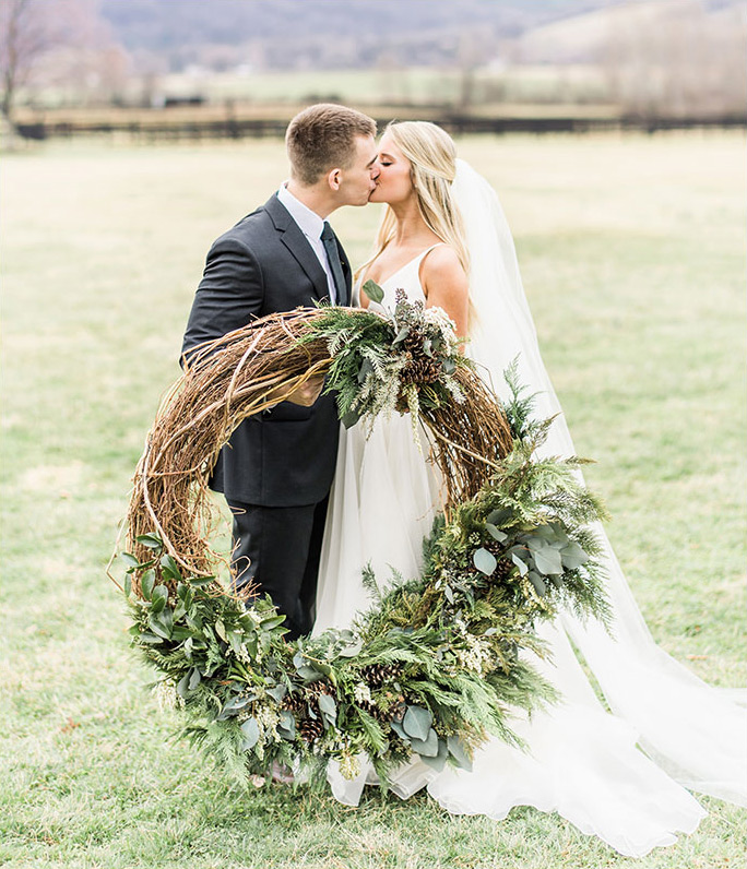 vineyard wedding couple with wreath
